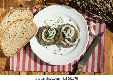 Meat from a pig's  head that is cooked and pressed in a pot with jelly. Brawn  as usually served in the Czech Republic. Tla?enka/ Brawn slices on a plate - Shutterstock ID 619561178
