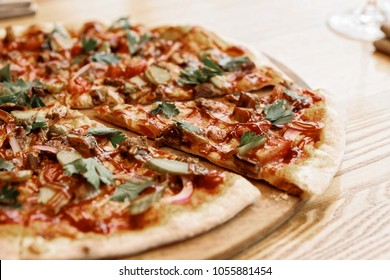 Meat pizza with hot barbecue sauce and pickled cucumbers, toned picture