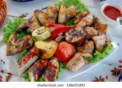 Meat plate - grilled kebabs from chiken meat, with grilled vegetables, great image for your needs.