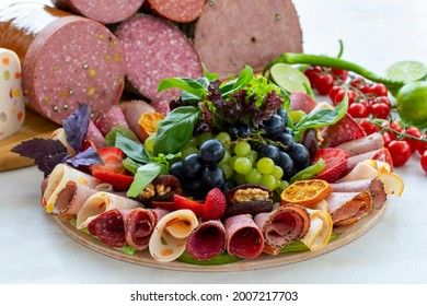 Meat plate on a white wooden background. Set of Salami. Cold cuts of different types of meat. Antipasto set platter. meat snack plat. horizontal view