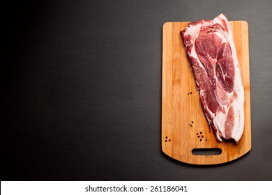 Meat pork fresh. Raw meat on cutting board. Spice and meat. Fat piece
