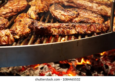 meat pork ribs are roasted on coals. Barbecue on grill in the smoke