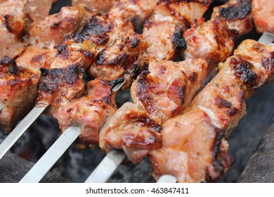 Meat porkis fried on the grill skewers at the coals