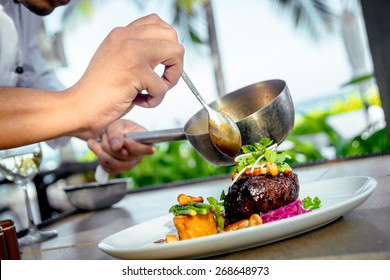 Meat with potatoes and asparagus on a white plate. The Restaurant