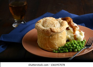 meat pub pie with mashed potato and gravy