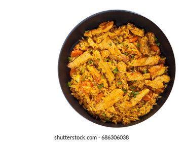 meat with rice and vegetables in a frying pan. top view. isolated on white