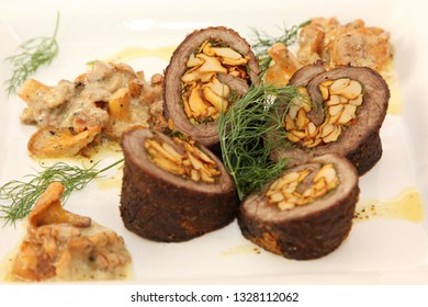Meat roll filled with fried chanterelles served with chanterelle sauce