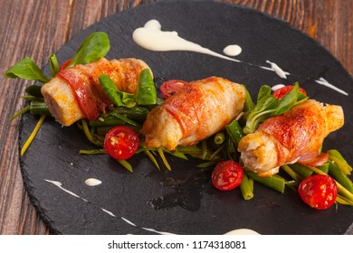 Meat rolls with Bacon with cherry sauce