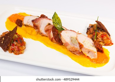 meat rolls with sauce and vegetable caviar on plate