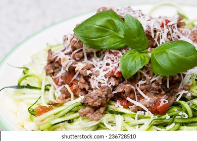 meat sauce with fresh garter cheese and green zucchini cut like spaghetti for a pasta substitute