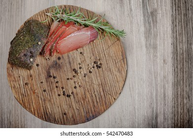 Meat and sausages on wooden background.