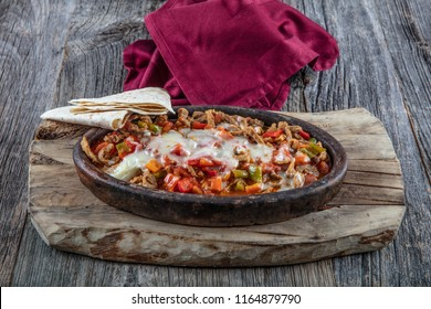 Meat Saute Turkish Et sote with wooden table. Turkish sauted meat casserole