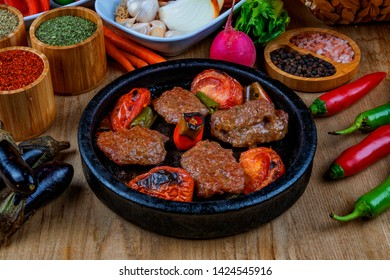 Meat Saute Turkish Et sote with wooden table - Hair Pie Meat - Sac Tava - Sac Kavurma