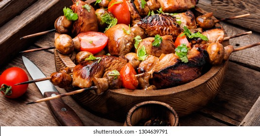 Meat shish kebab with mushrooms and spices.Traditional Russian shashlik.Long banner