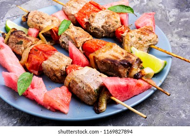 Meat, shish kebab on skewers with watermelon. Summer recipe for shish kebab.Eastern food