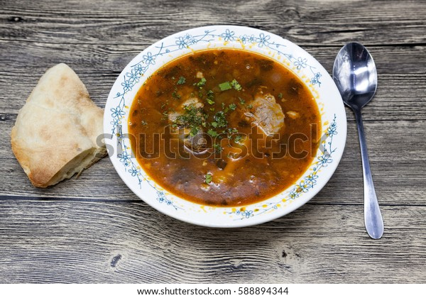 Meat soup beef with pepper and tomato.