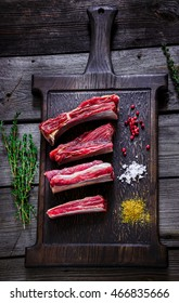 Meat and spices on dark wooden table. Style rustic, Selective focus.