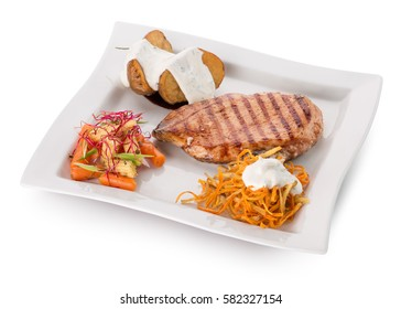 meat steak with baked potatoes with tartar sauce and korean carrots