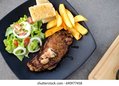 Meat Steak with salad and French Fries and sauce