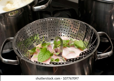 Meat steam cooking in stainless pot