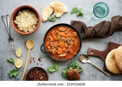 Meat stew in pan with mushrooms and vegetables. Slow cooked seasonal food