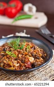 Meat stew in rustic arrangement