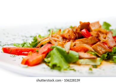 Meat stew with vegetables decorated leaf lettuce isolated on white background macro. A series of food in a restaurant close-up