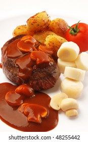 meat with tomate sauce with mushrooms, potato and heart of palm