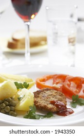 meat with vegetable garnish and wine