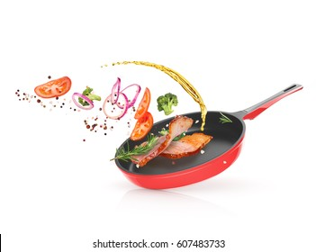 Meat with vegetables in a frying pan