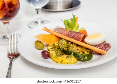 Meat and Vegetables on Antipasto Plate on formal table