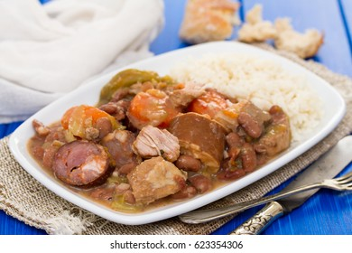 meat with vegetables and sausages on plate