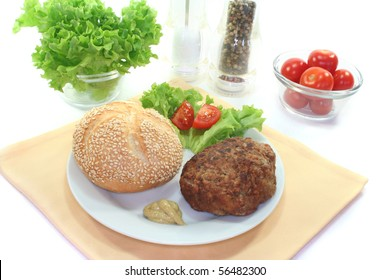 meatball with bun, fresh lettuce and tomato pieces