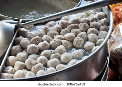 Meatball made of pork or beef or chicken being boiled in stainless hot pot ready to eat or put in noodle bowl.