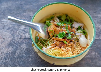 Thai​ noddle​ with meatball on wooden table