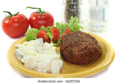 Meatball with potato salad, fresh lettuce and tomato pieces