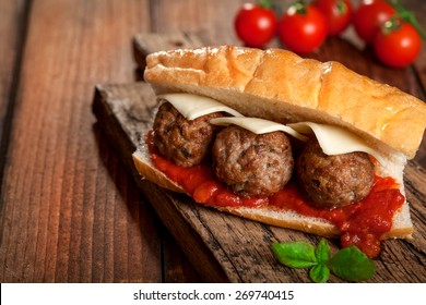 Meatball sandwich in tomato sauce