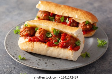 meatball sub sandwich with cheese and marinara tomato sauce. american italian fast food