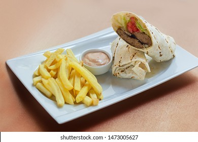 Meatball Wrap with sause and fried potatoes