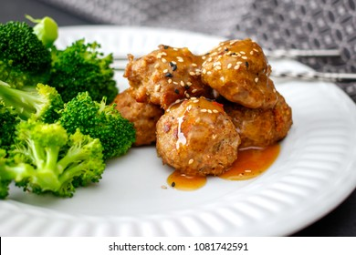 Meatballs and broccoli on a white background