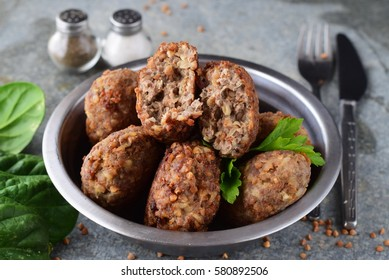 Meatballs with buckwheat in a metal bowl. Healthy food.
