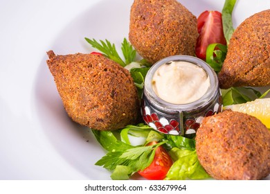Meatballs, deep fried, from wheat grains with pine nuts and onions