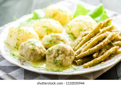 Meatballs in dill sauce with potatoes and green beans