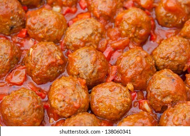 Meatballs with homemade tomato sauce in pan. selective focus
