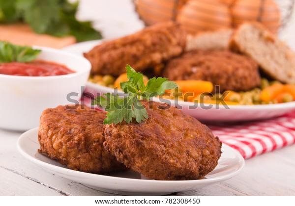meatballs-on-white-dish-600w-782308450.j