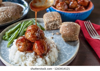 meatballs and sauce on rice