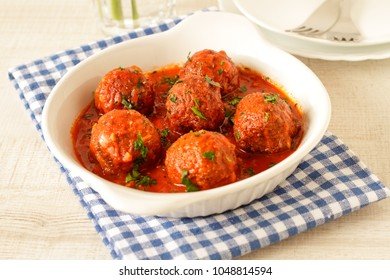 Meatballs with spicy tomato sauce on a plate