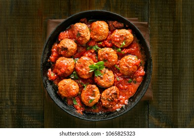 Meatballs with tomato sauce in frying pan, top view