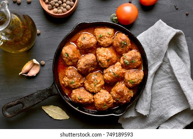Meatballs with tomato sauce in frying pan. Top view, flat lay