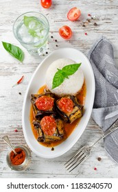 Meatballs wrapped in eggplant on a plate of rice. Traditional Turkish dish Islim Kebabi (Kürdan Kebabi)
